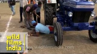 Life threatening sport - men crushed under a tractor at Kila Raipur