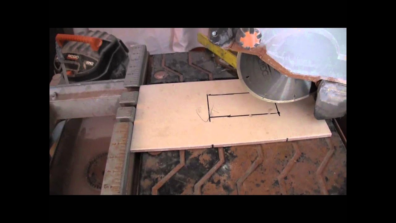 Cutting an Outlet Hole Into a Tile - YouTube