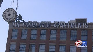 """The Clock Man"" work of art now on display at a Providence apartment complex."
