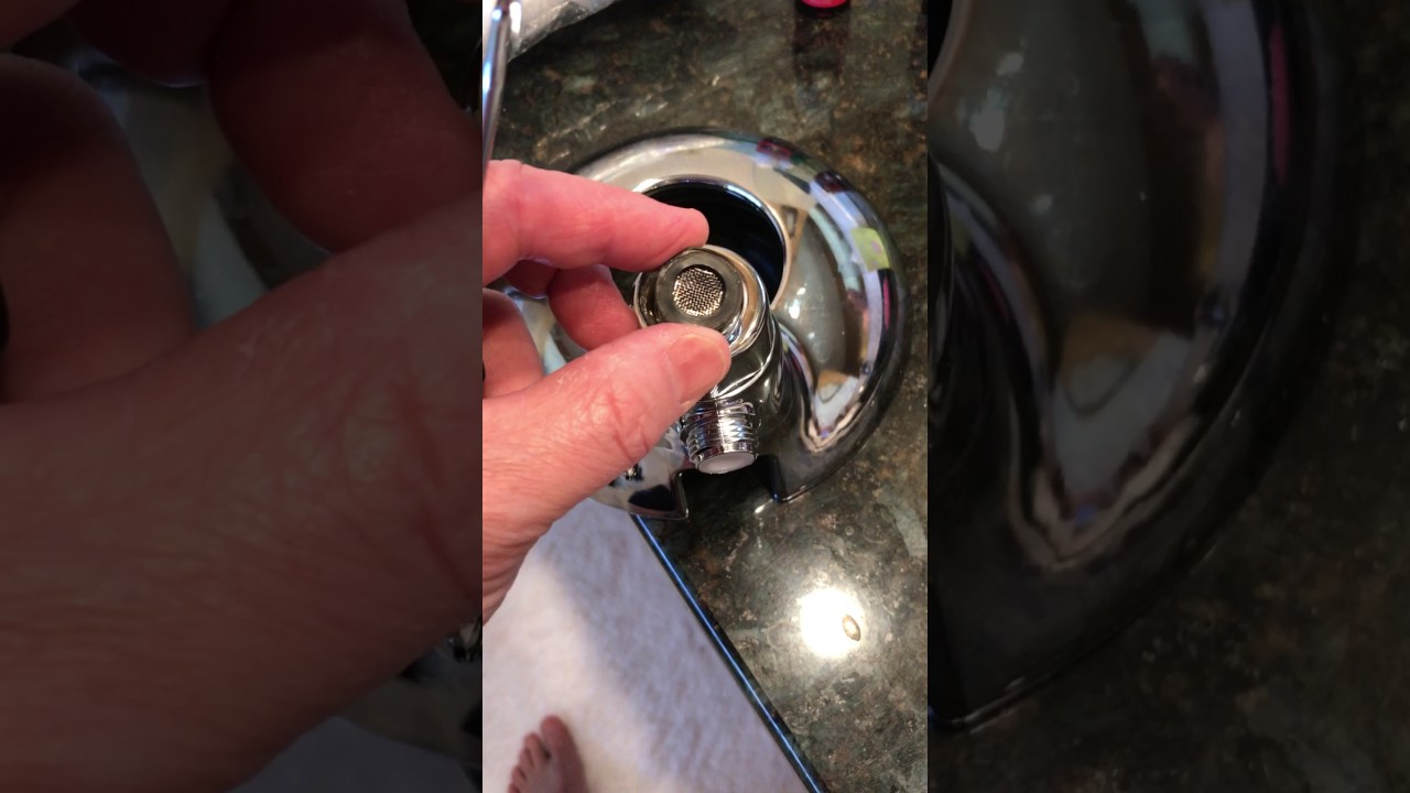 Remove Flow Restrictor on Delta 58469 Shower Head - YouTube