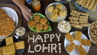 Hands of an Indian woman serving peanuts chikki on Lohri the harvest festival in India