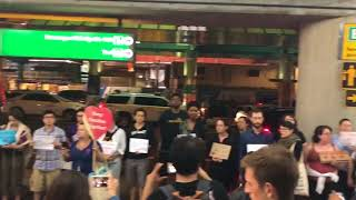 Crowd gathers at LaGuardia Airport to support children believed to be separated from families