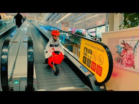 Funny Den ride on red sportbike to the kids store buy new toy 0+