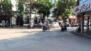 Morning traffic in Haiphong, Vietnam near Pizza Hut