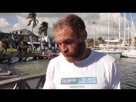 Damian Browne finishes his solo row across the Atlantic after 64 days