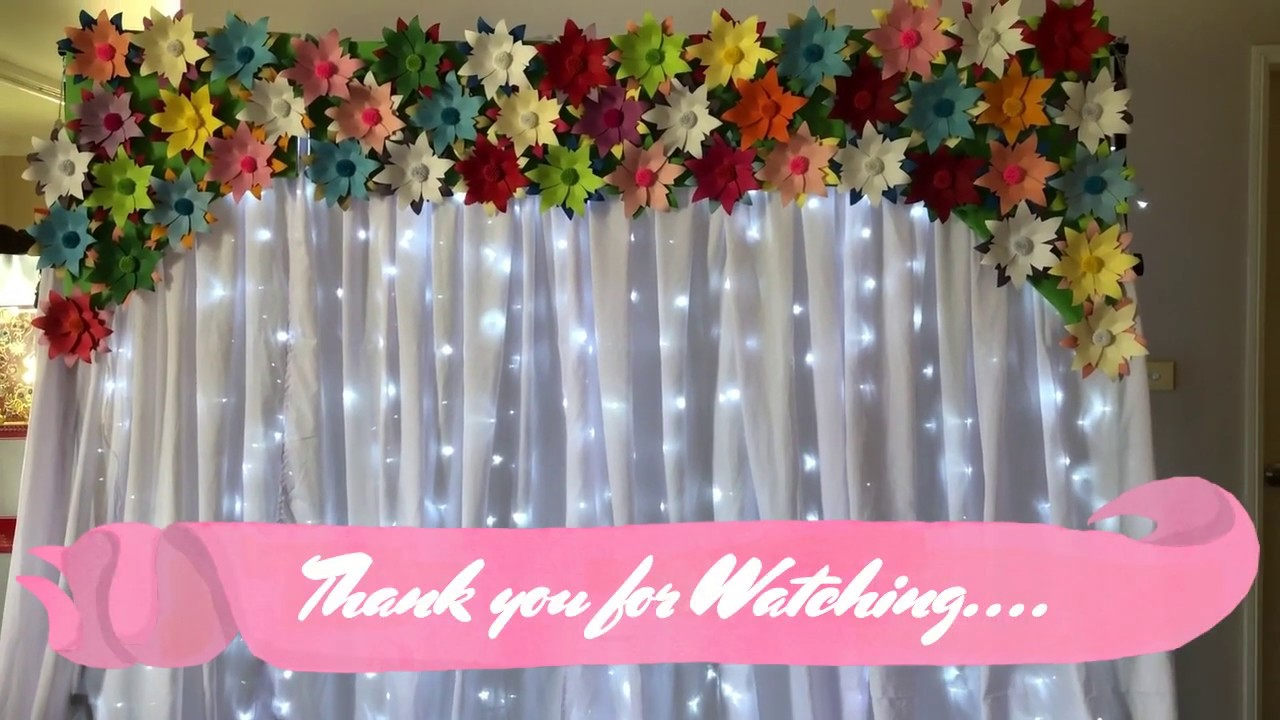 diy flower backdrop with white curtain and fairy lights