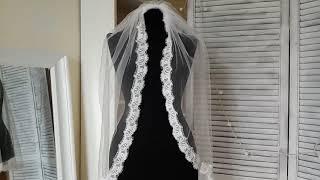 Свадебная фата белая с тонким кружевом, собранная на гребешке