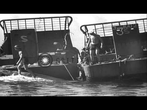 US personnel salvage a sunken LC (Landing Craft) in Purata Island. HD Stock Footage