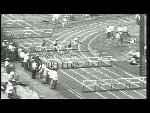 People look as US athletes perform during AAU ( Amateur Athletic Union ) track me...HD Stock Footage