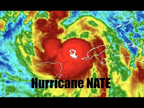 UPDATE: NATE appears to have rapidly intensified - Rare feature appears above storm!