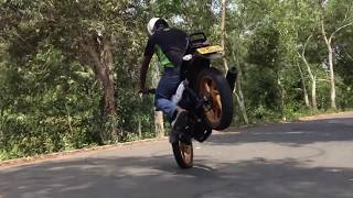 Pulsar 150 Rolling Stoppie + Half turn.