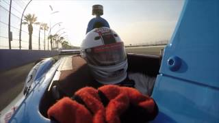 Jackie rides in an IndyCar with Mario Andretti