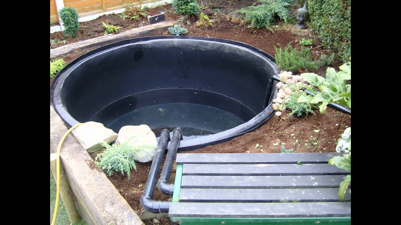 Preformed rigid pond liner installation kio fish ponds for Koi pond liner