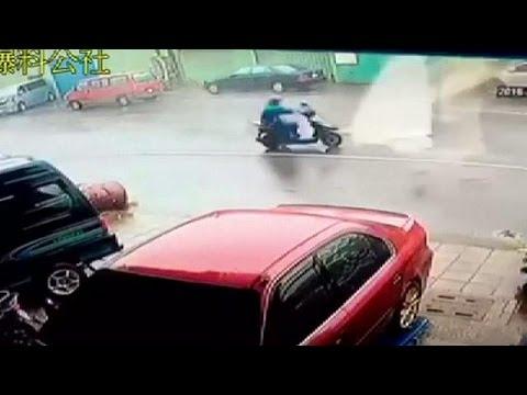 Taiwan: Motorbike rider blown away by typhoon