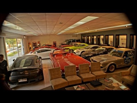 Dream garage showroom aston martin porsche for Garage porsche montelimar