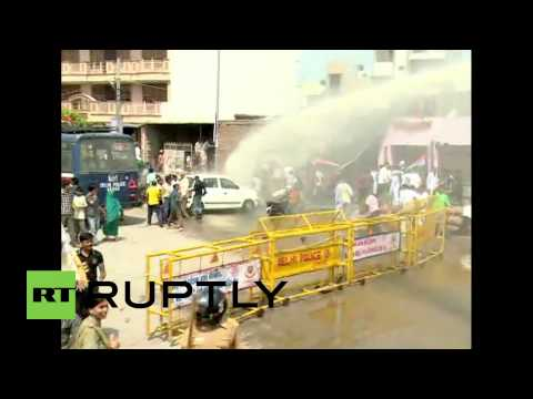 India: Police unleash water cannons on Delhi protesters