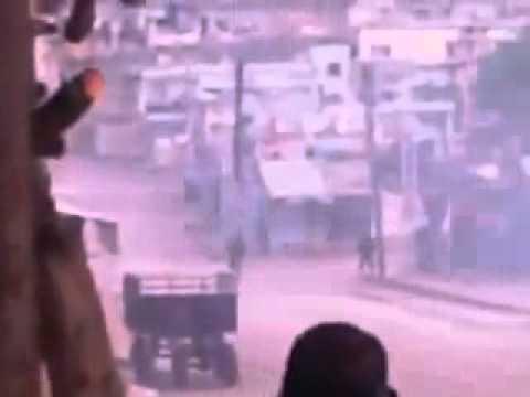 Syria - Homs - Ar Rastan - 20120106 - Residents Chanting  While Taking Cover For Shabiha Gunfire