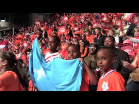 waving Somali blue flag in orange stadium Amsterdam