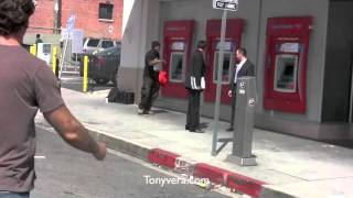 Man going off at bank of america & Anjelica Huston Giving money to the homeless man