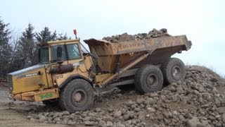 volvo a25c going up the stone pile