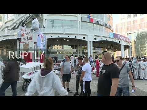 : Environmental activists protest outside International Motor Show IAA gates