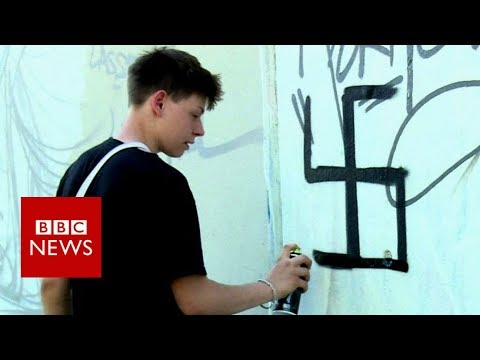 Berlin street artist group cleverly undo swastika graffiti- BBC News