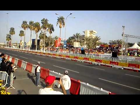 SCUDERIA FERRARI LIVE STREET DEMONSTRATION QATAR-Formula one fly by+pit stop