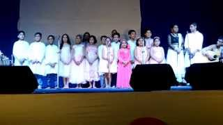 Students of Smt. Pallabita Ghosh singing Biswapita Tumi He Prabhu during  Durga Puja 2015