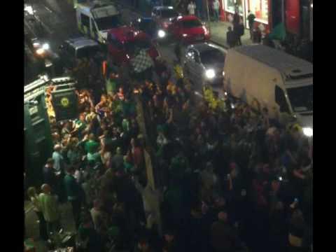 Hibs fans celebrating on Easter Road