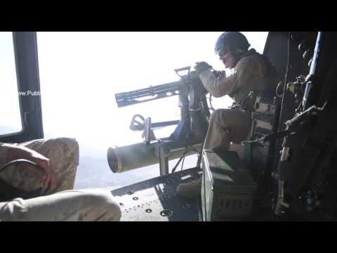 UH-1Y Huey Marine Crew Chief fires GAU-17/A minigun from archival footage
