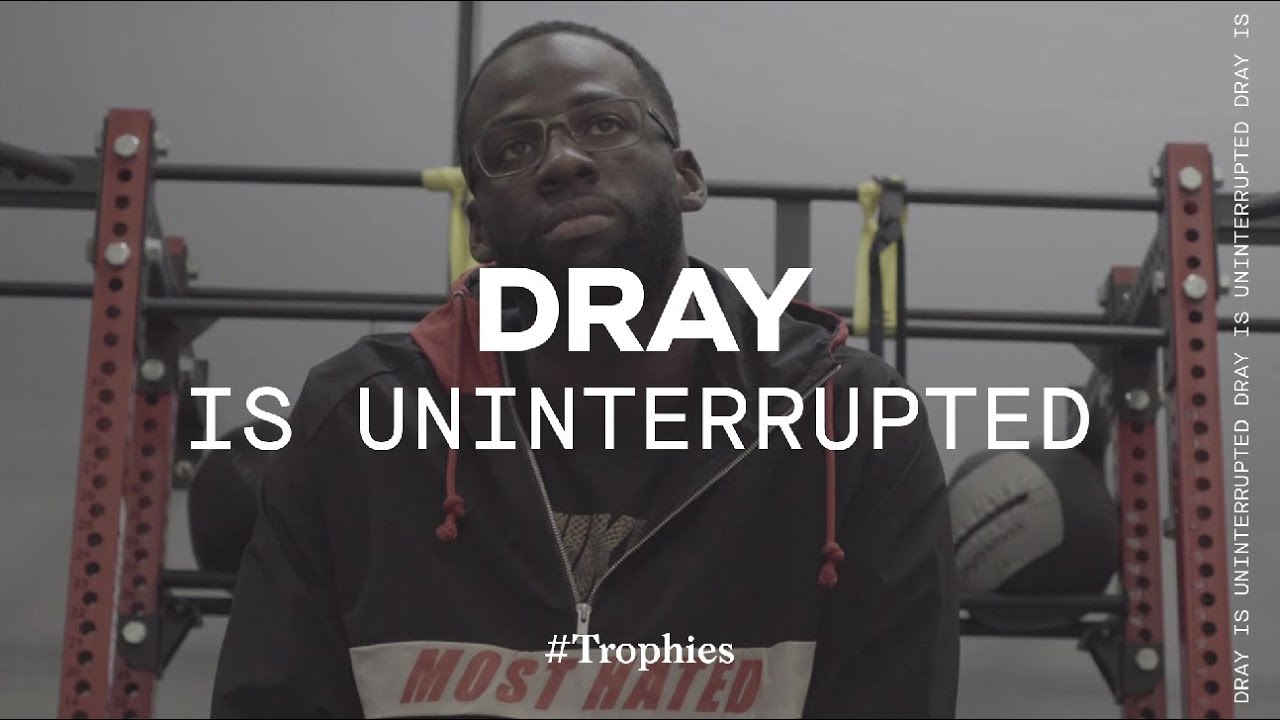 draymond-green-prepares-to-face-the-rockets-trophies