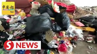Three sisters living in filth-strewn shophouse sent to children's home