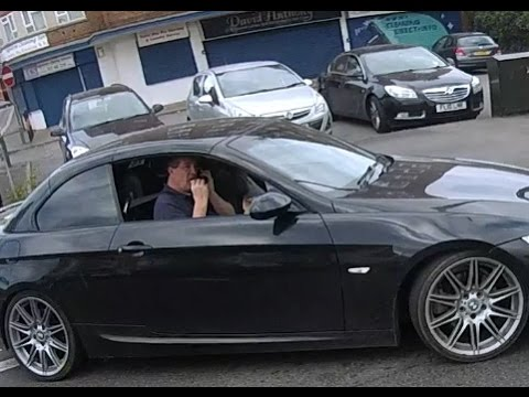 BMW Driver using a mobile phone and eating a burger