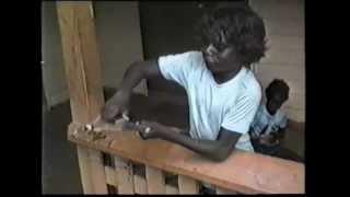 Tiwi Aboriginal boys learning to make spears, Australia