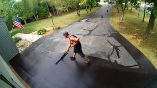 I had a contractor come and sealcoat my driveway - timelapse.
