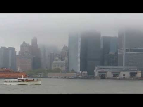 Scraping the sky: Downtown Manhattan under low cloud cover