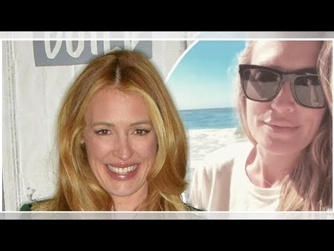 Cat Deeley covers up growing pregnancy bump as she glows on the beach during Earth Day celebrations