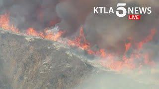 Crews battle Ranch Fire threatening homes in Azusa