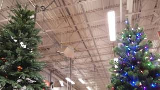 Home Depot has an artificial Christmas tree that changes height fro...