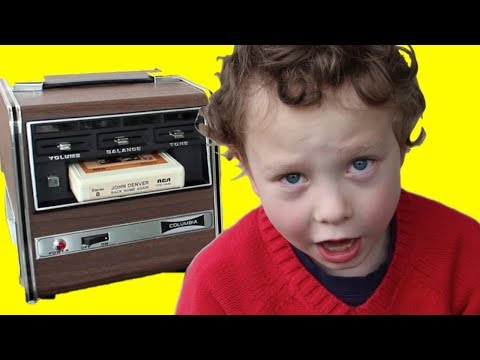 Kid plays an 8-track player for the first...