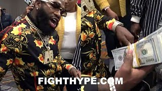 ADRIEN BRONER PEACOCKING FLOSSIN AND PUTS JEWELER ON FRONT STREET IN FRONT OF FANS