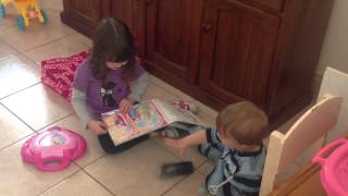 Mikayla reading to Bastian. Thumbnail