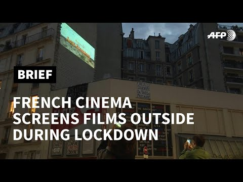 Paris cinema projects films to cheer up residents on lockdown | AFP