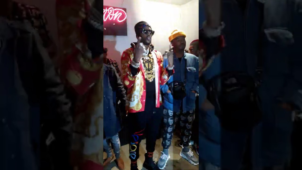 2 Chainz and Wife Enter His Versace Pop-Up Event in Atlanta During Super  Bowl