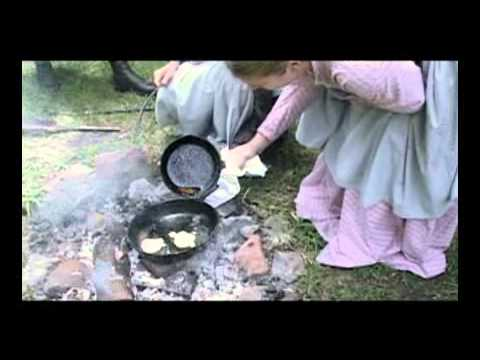 Cooking hoe cakes on an open fire - YouTube
