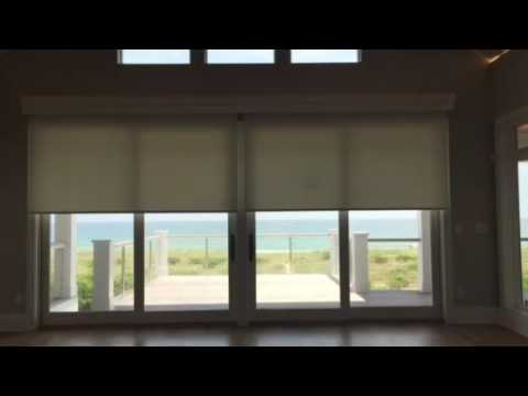 Motorized sliding door shade