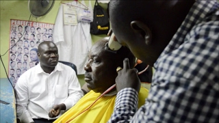 Governor Ranguma gets a clean shave at a local kinyozi