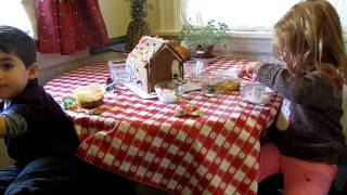 Minnie and ZakZak decorate gingerbread house