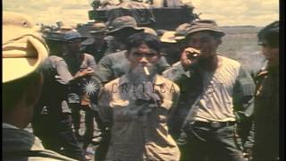 Interrogation of North Vietnamese prisoners by ARVN soldiers in Vietnam during th...HD Stock Footage