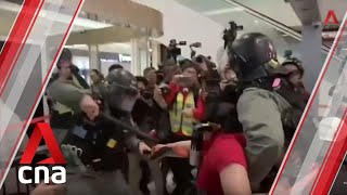 Riot police and protesters clash in Sheung Shui shopping mall